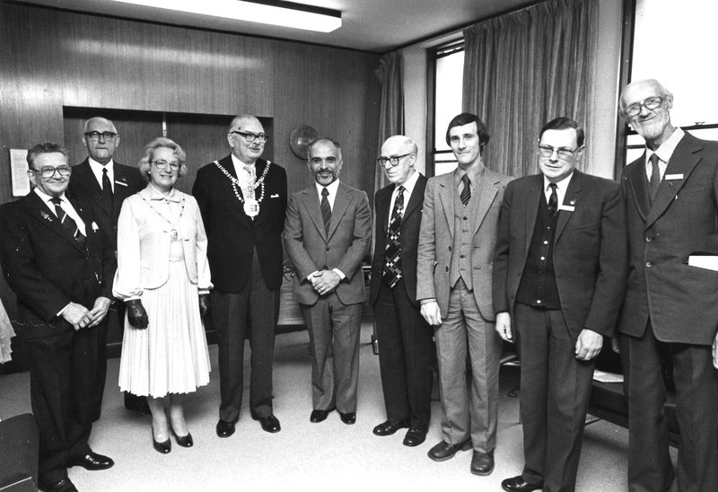 The photo shows King Hussein with some of the Club members and the Mayor and Mayoress of Harrow . From left to right: Bill Corsham G2UV; Norman Joly G3FNJ; Mayoress of Harrow; Mayor of Harrow; King Hussein JY1; Geoff Hodges G3KRT; Chris Friel G4AUF; Don Nappin G3MLS; Maynard DeBorde G4LKO